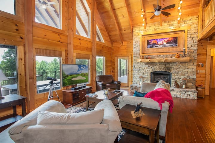 Living Room with HDTV and Stone Fireplace with Gas Logs