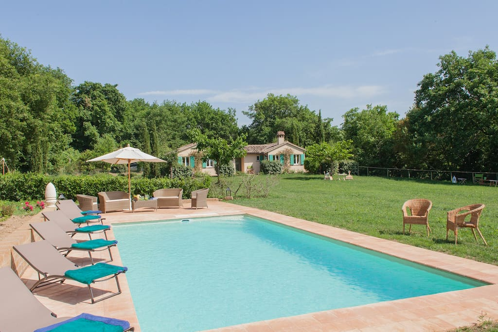 the swimming pool (10 x 5 meters) equipped with sun beds, beach umbrellas and chairs