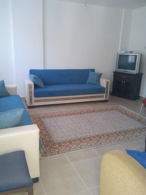 Large Lounge with bed settee, TV and Satellite, with access to balcony