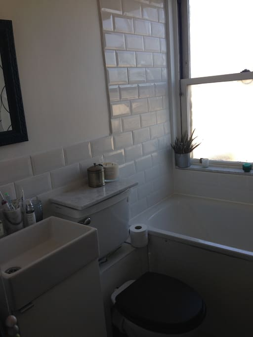 Newly decorated bathroom with bath tub and marble features