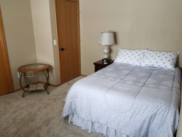 Bedroom 2 includes a new full size bed and a night stand with electric and USB outlets for charging your devices.