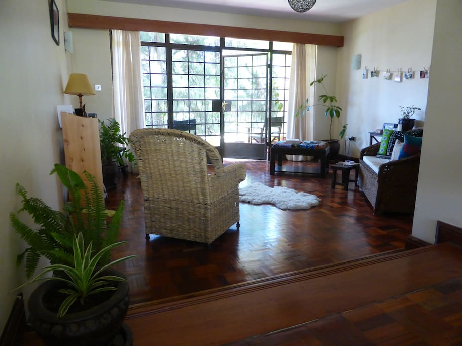 Lovely light, spacious sitting room with plant-lined balcony looking over garden