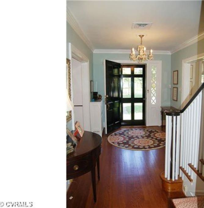 original wood floors, staircase with natural lighting