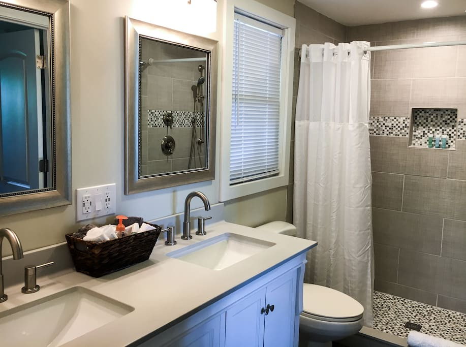 Beautiful all new bathroom with walk in shower, including Moen rainfall shower head