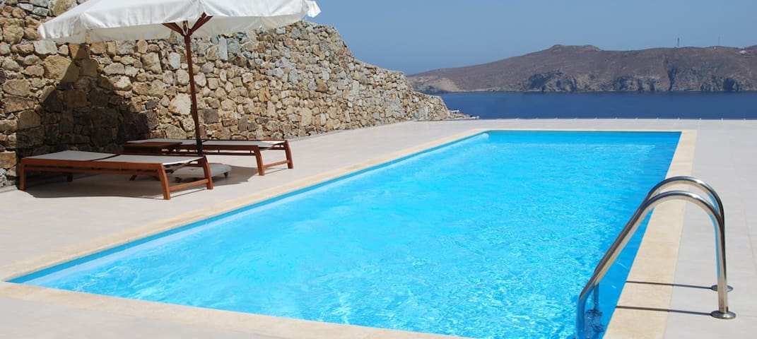Pool overlooking Panormos Bay