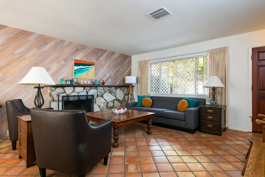 Spanish tile floors greet you as you enter the home into the inviting living room