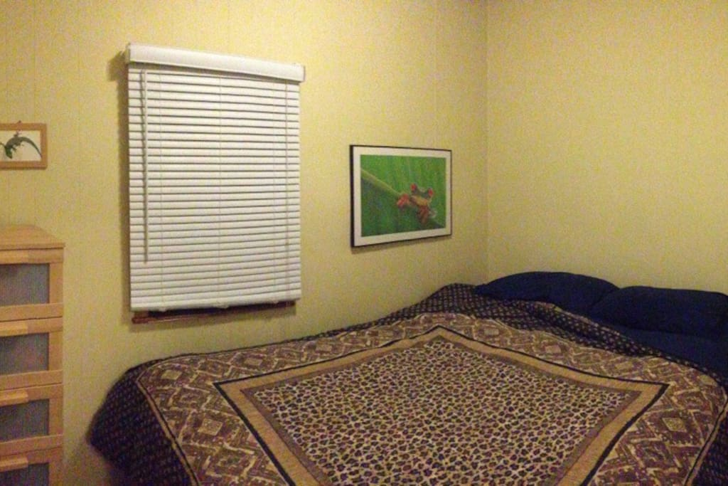 Small second bedroom is cozy for two.