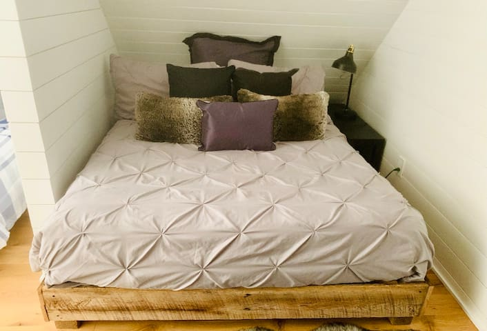 """Sleep/Work Section of the Loft: Queen-size bed and full-size desk. Plus, there is a  39"""" Smart TV on a swivel mount for easy viewing while relaxing in bed."""
