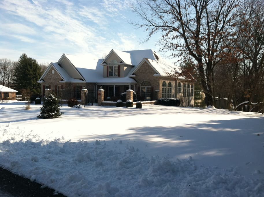 Winter view of 1-1/2 story home, great creative getaway