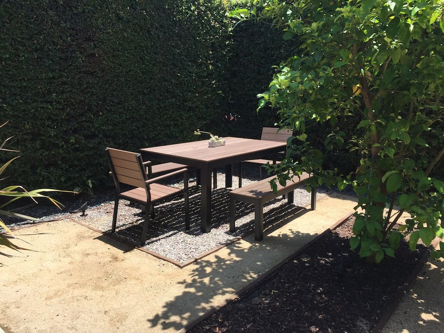Outdoor seating for 6 provided in a secluded private setting