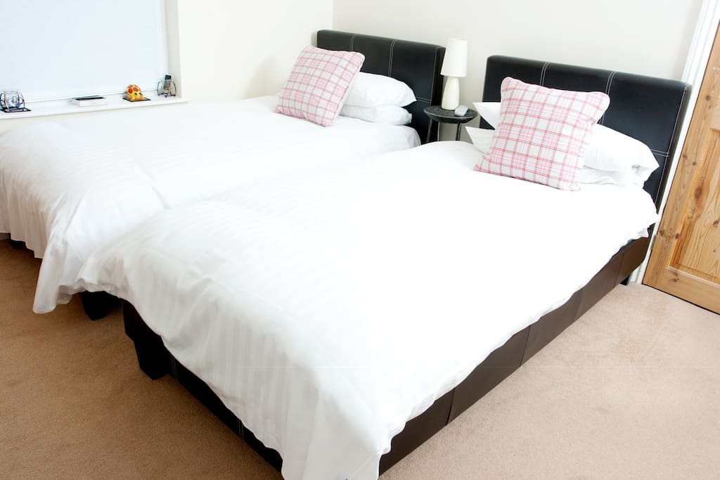 Twin room with comfortable beds and quality linen