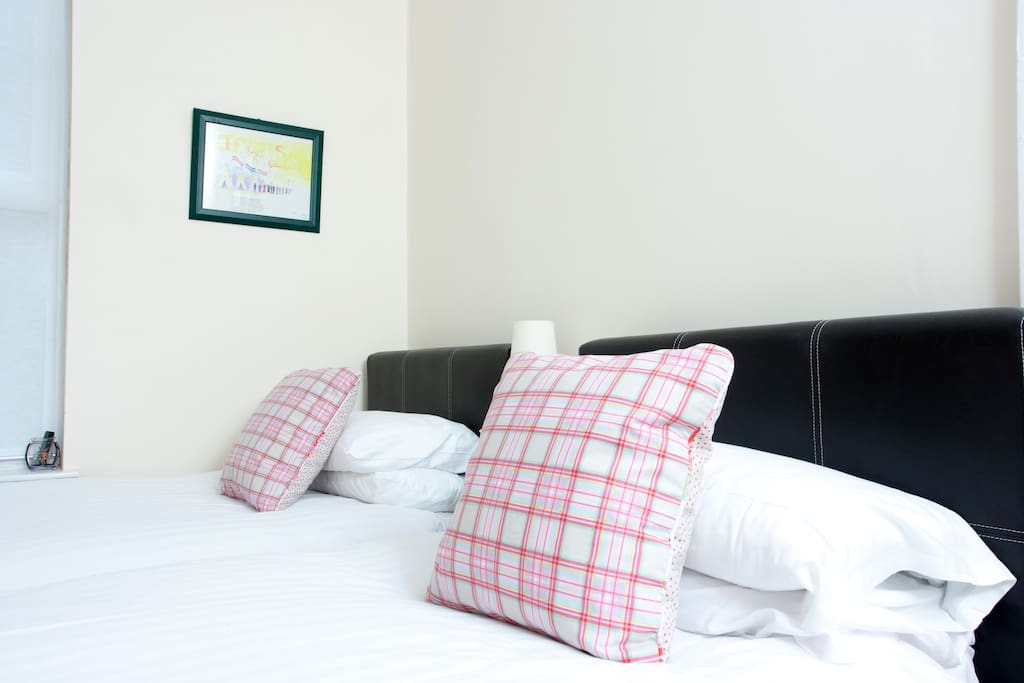 Twin room with comfortable beds, quality linen, overlooking rear garden