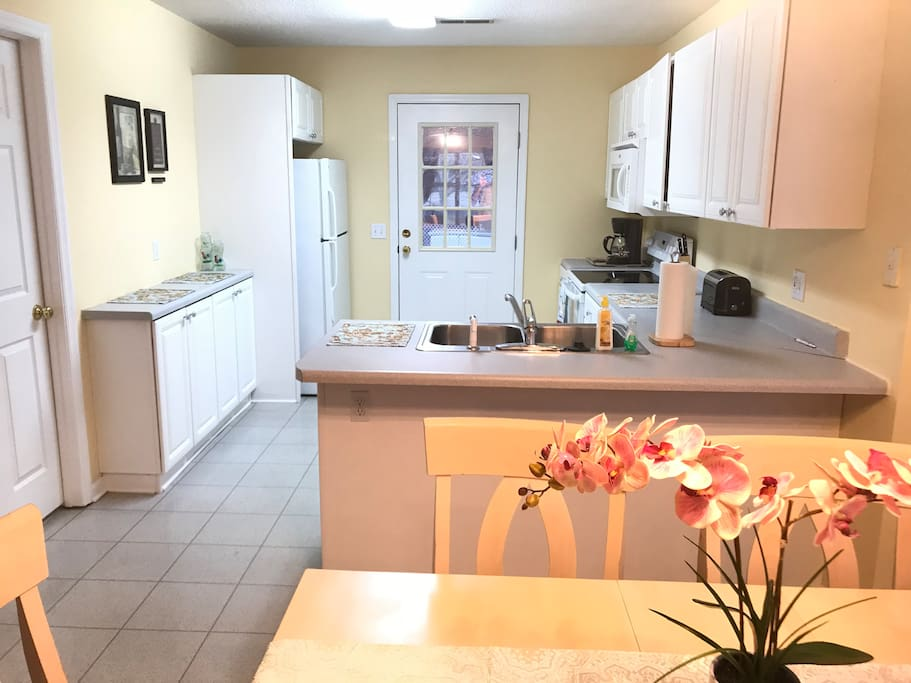 Updated kitchen with all the amenities needed for a comfortable stay.