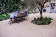 Private courtyard with dining table