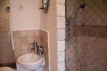 Outbuilding bathroom with toilet and shower
