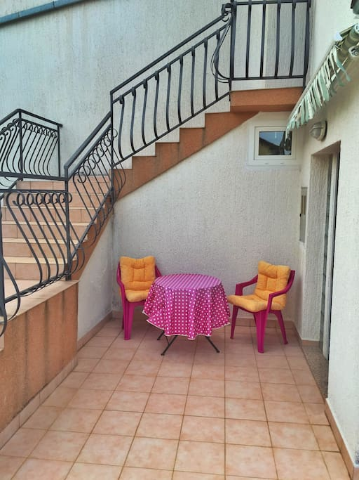 Outdoor table on terrace.
