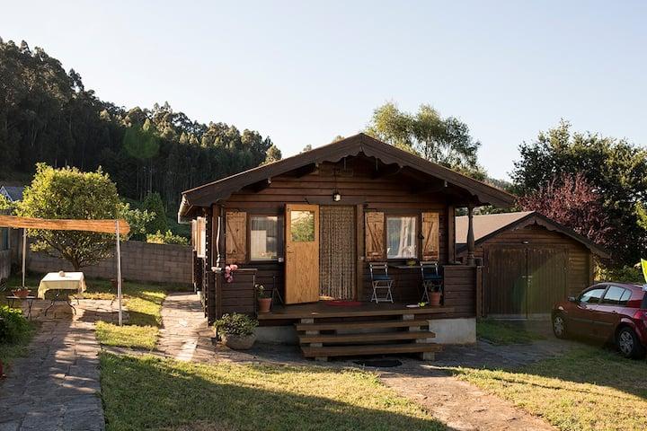 Acogedora cabaña de madera con vistas playa Covas