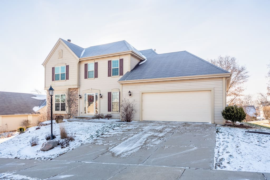 House is in a quiet suburban Waukesha neighborhood on a hill.