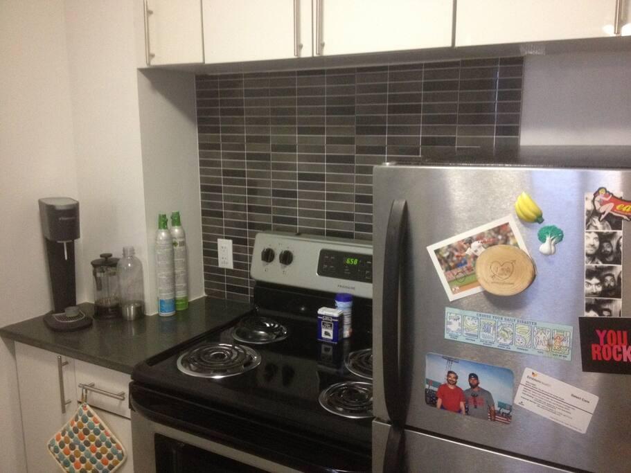 Kitchen with oven, stove, dishwasher