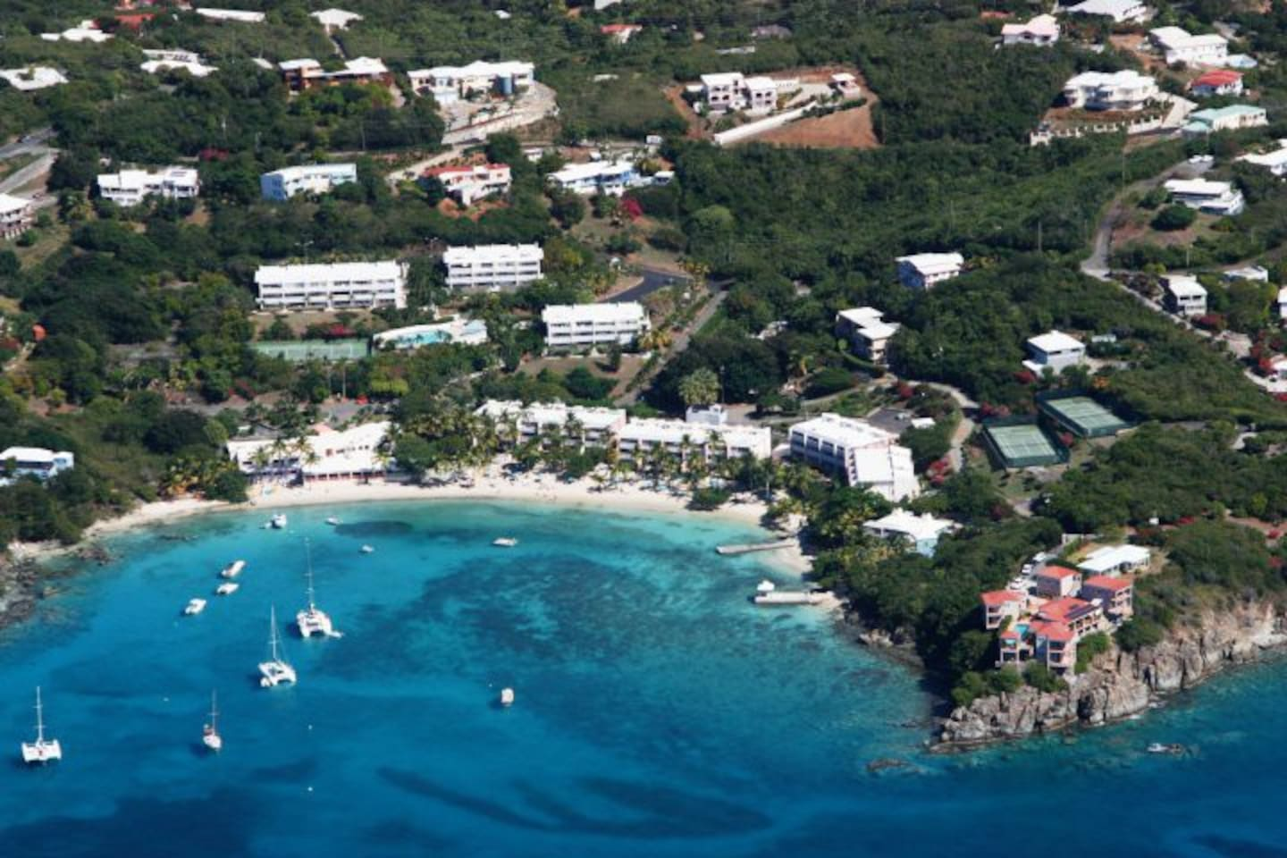 Our Place in St thomas is up to the left above Secret Harbour hotel