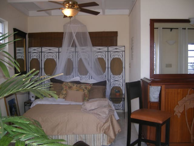 Queen size bed in the studio cottage