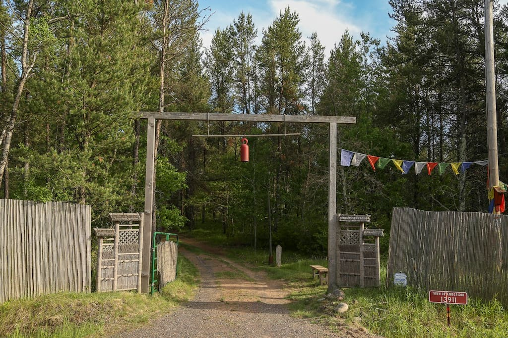 Entry gate by road. Winding ¼ mi long driveway leads you to the cabin and river.