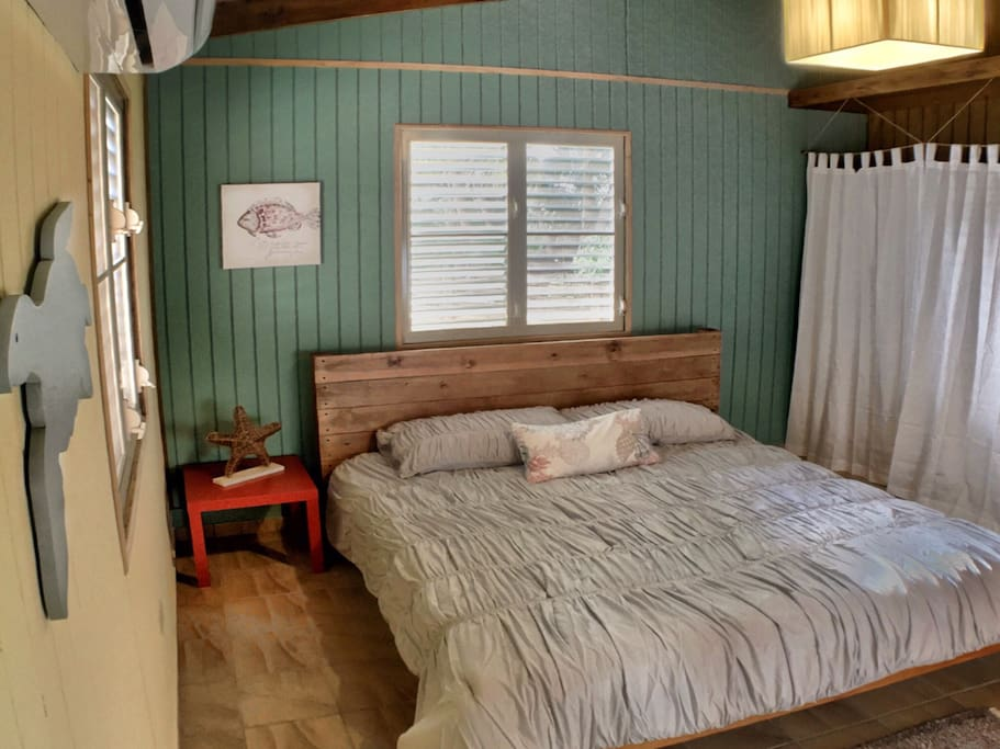 Master Bedroom - King size bed was handcrafted by the owners. Room has Air Conditioner.
