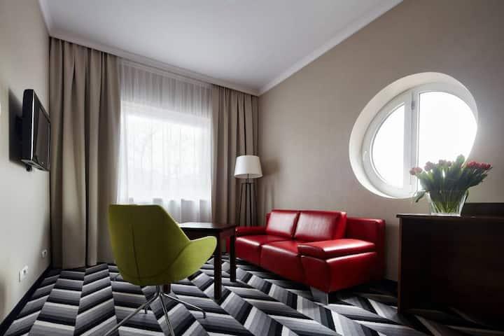 Trzyosobowy pokój Deluxe w hotelu 4*