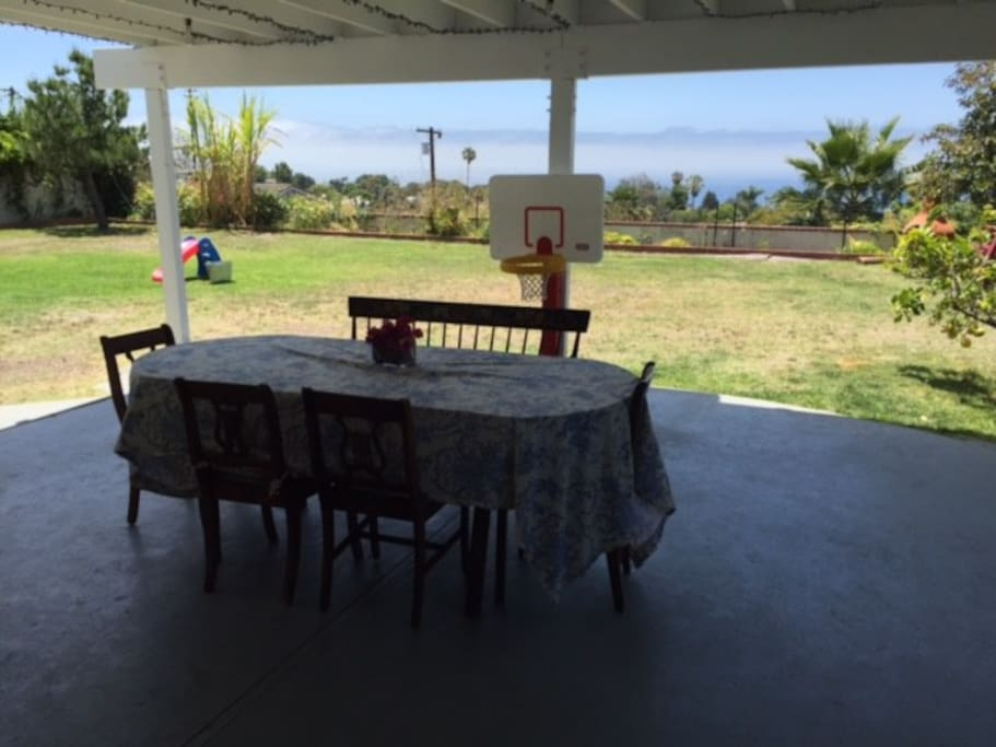Large patio and fenced in yard with stunning ocean views! Kiddie pool & outdoor toys too!