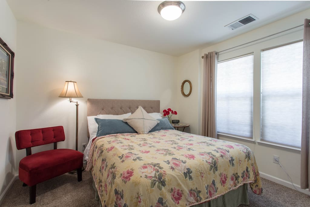 Bright sunny room with clean comfortable bed