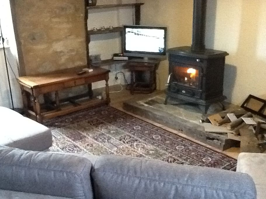 Cosy log burning stove in the sitting room. Happy to help you light it!