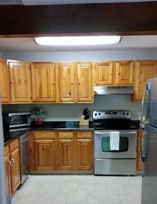 Updated kitchen, fully stocked, granite countertops and all stainless appliances