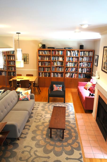 1st floor living room (view from staircase): 1 large couch, 1 fold-out couch, expandable dining table for up to 8, additional expandable dining talbe up to 6.