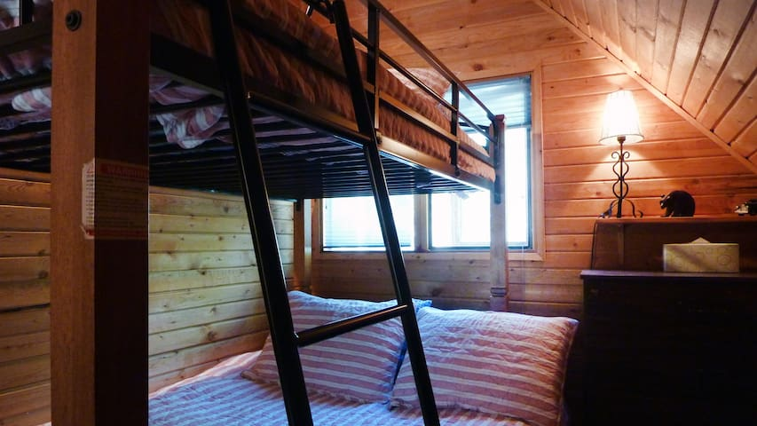 Bunk bed in upstairs bedroom sleeps two down and one up.