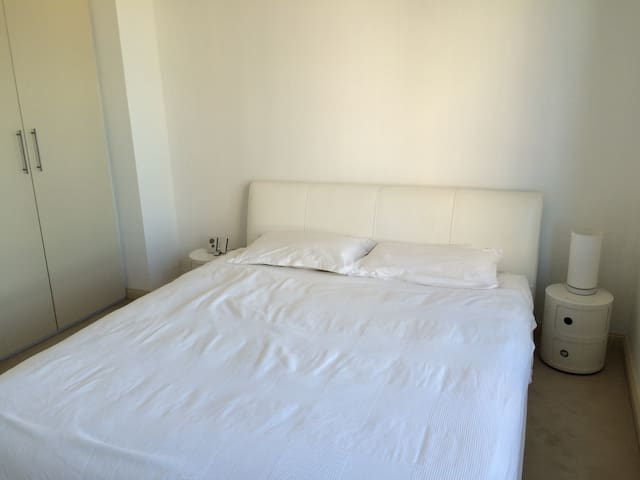 Bedroom with king bed & high quality latex mattress.