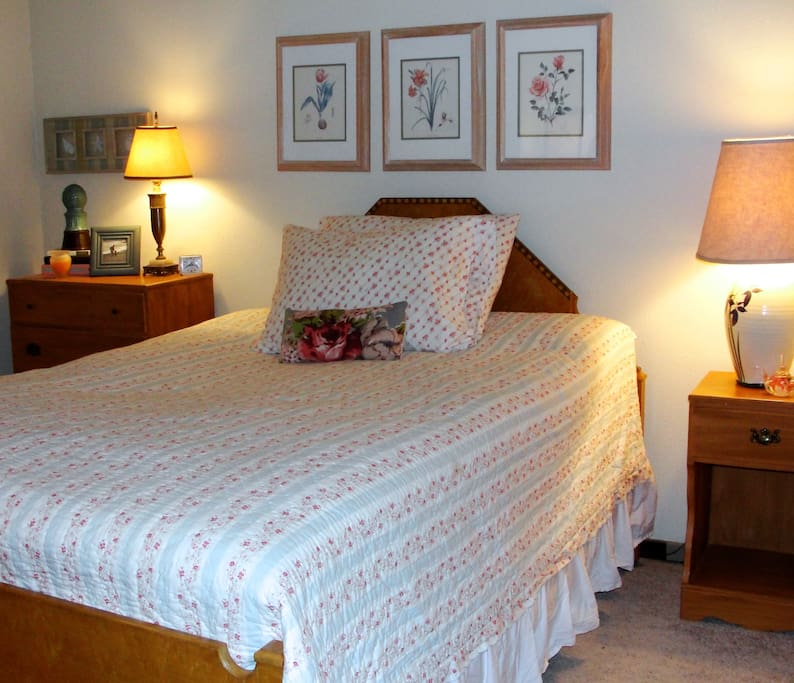 Double Bedroom furnished with antiques & feather bed.