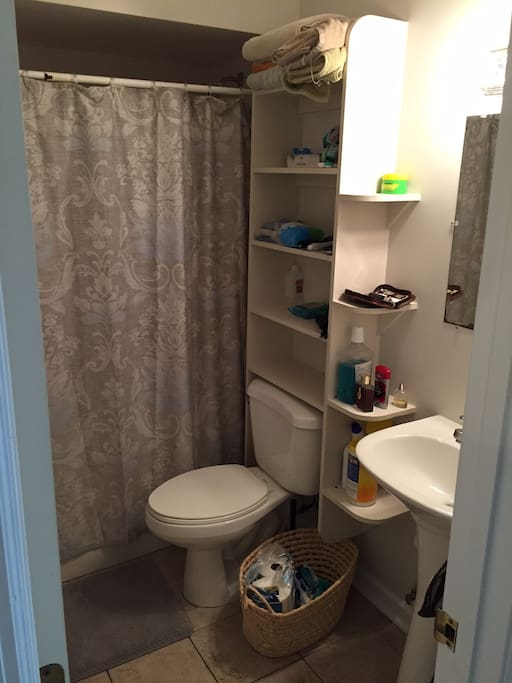 Bathroom with plenty of towels and other amenities