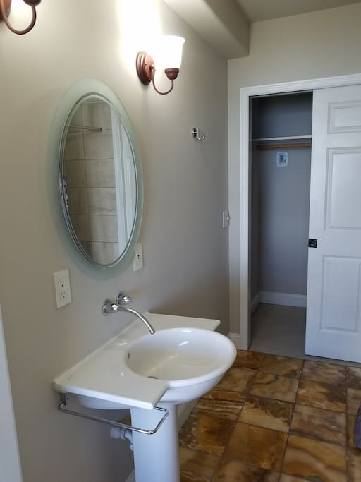 Large bathroom with tile shower and walk-in closet.