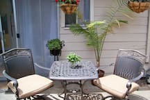 Comfortable outdoor furniture in front of the cottage