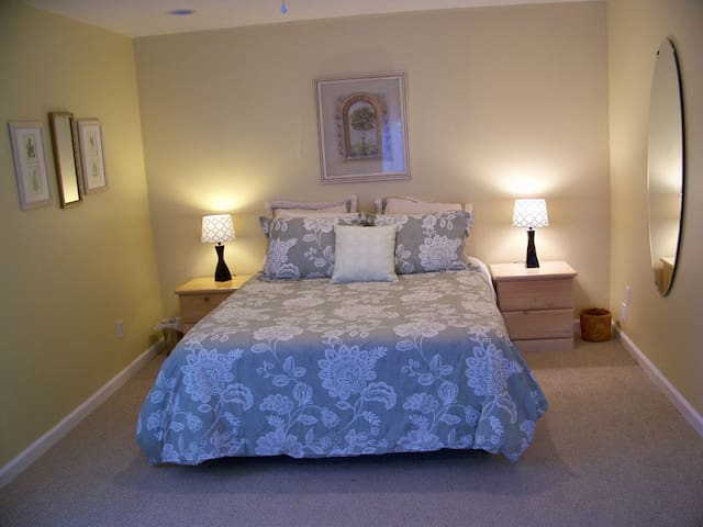 comfortable queen-size bed with all-cotton sheets and duvet
