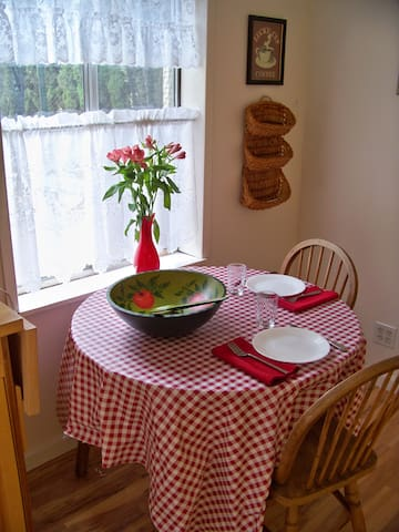 The dining table extends to seat 6, and has 4 matching chairs