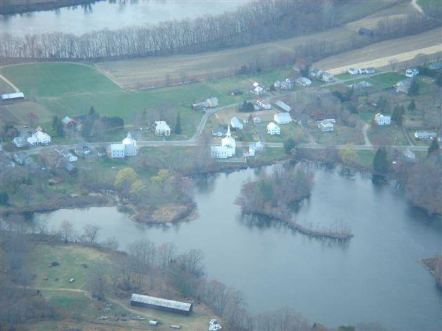Aerial view of North Hadley Village, Lake Warner, the CT River in back. Our street is opposite church steeple.