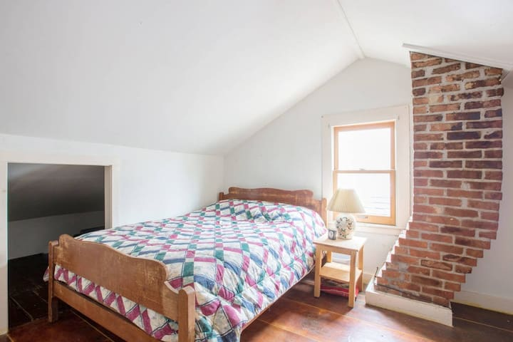 Loft bedroom in restored 1800's village duplex - Saugerties