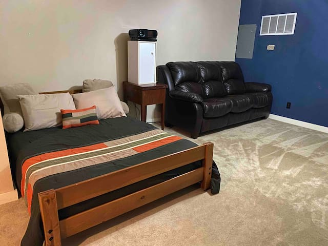 Full size bed and hide-a-bed couch in The Blue Room. We also have a DVD player with a projector system in this room for a fun movie night!