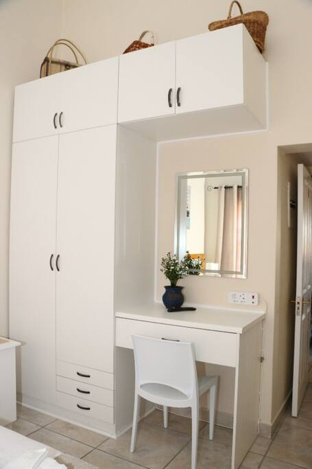 Wardrobe with mirror, chair, drawers.