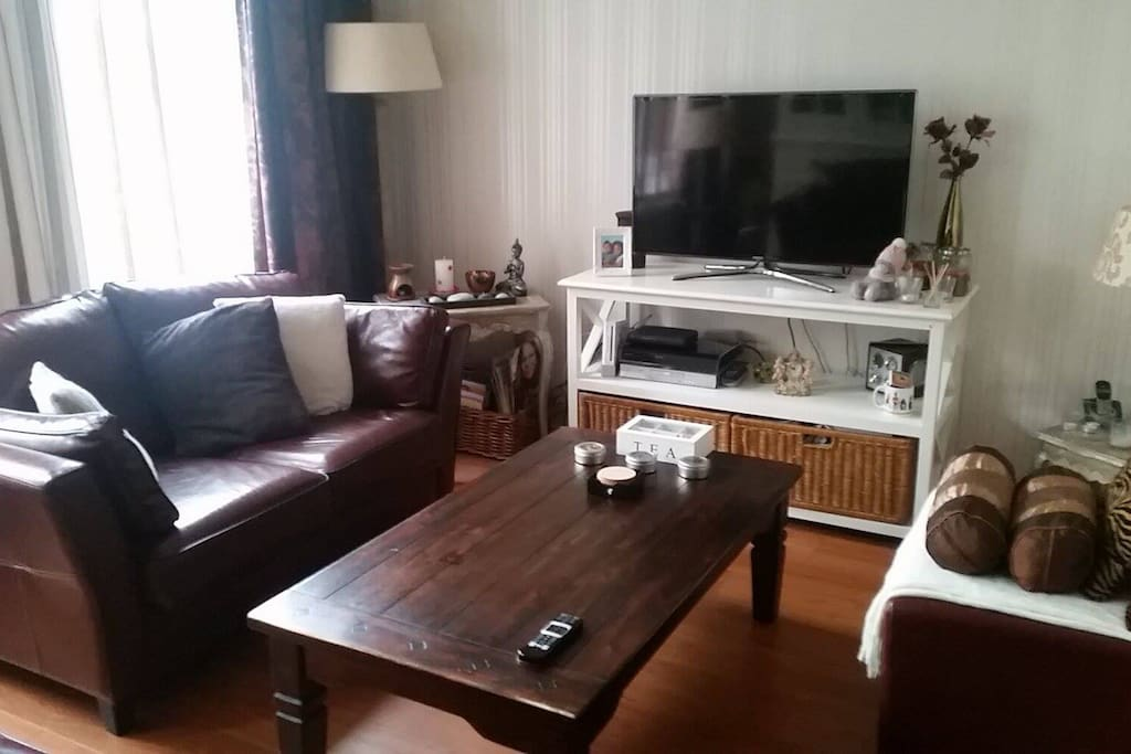 Living room with comfy couches and a flat screen TV