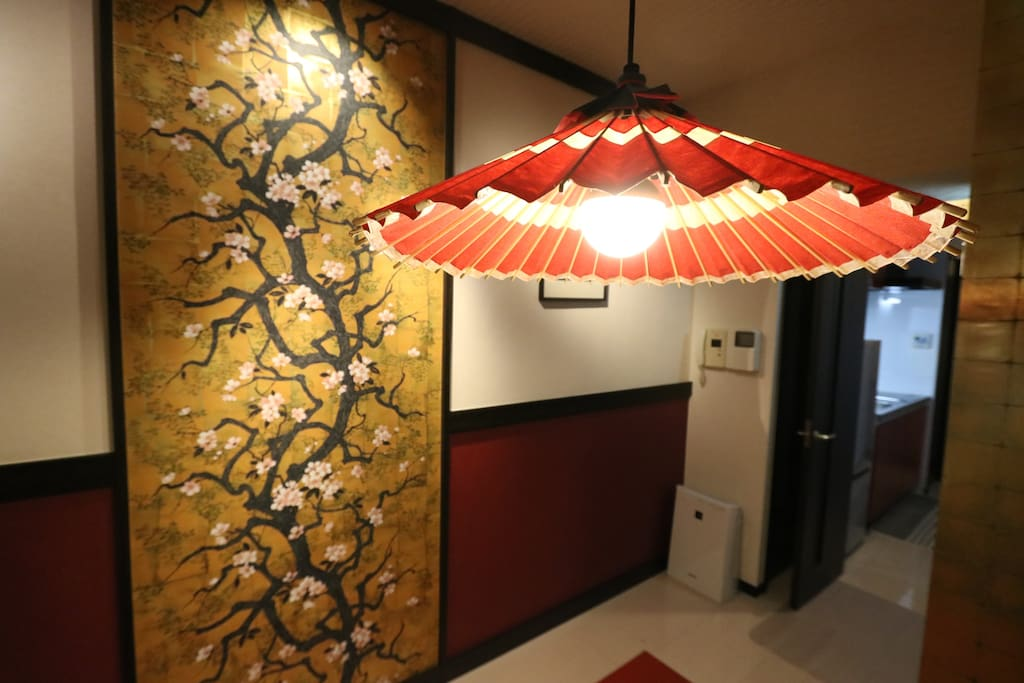 Japanese lamps are placed to make this Sakura wall decor come to life.