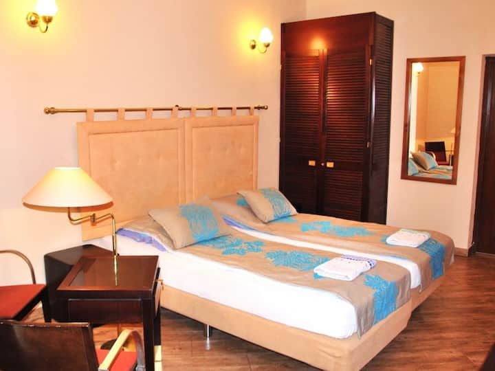 Double room with private bathroom Pavilion. Pensjonacik Ogrody