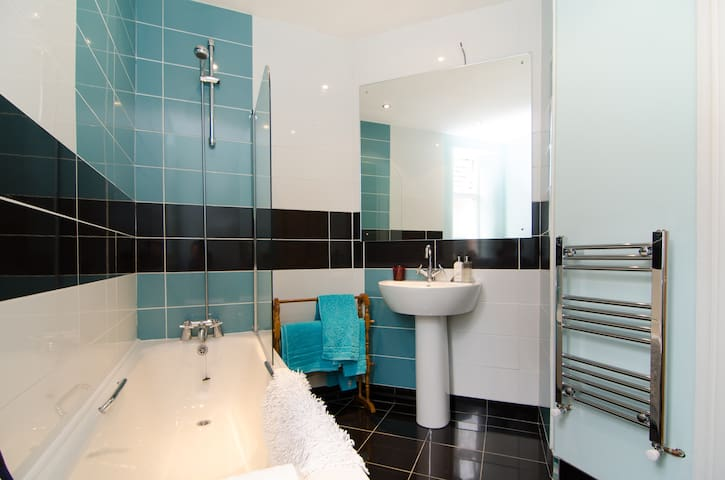 This bathroom goes with the room. There is a bathtub with a shower over.