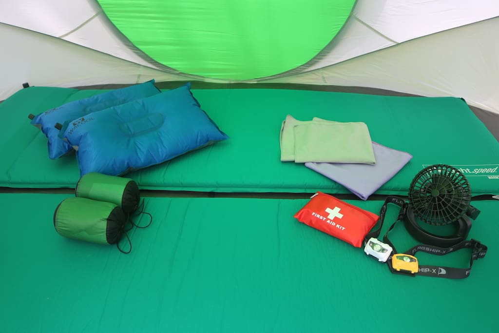 Two mats, two pillows, two headlamps, two towels, a lantern/fan and a small first aid kit. All conveniently pack for your travels.